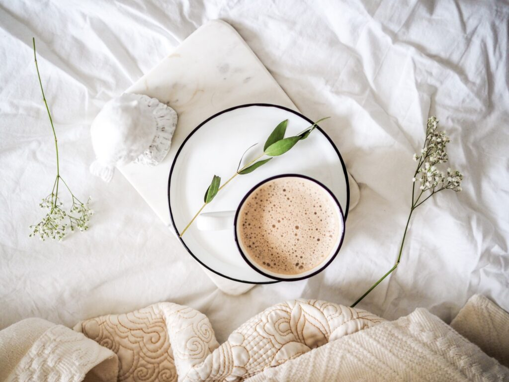 Cup of tea and leaves on blanket